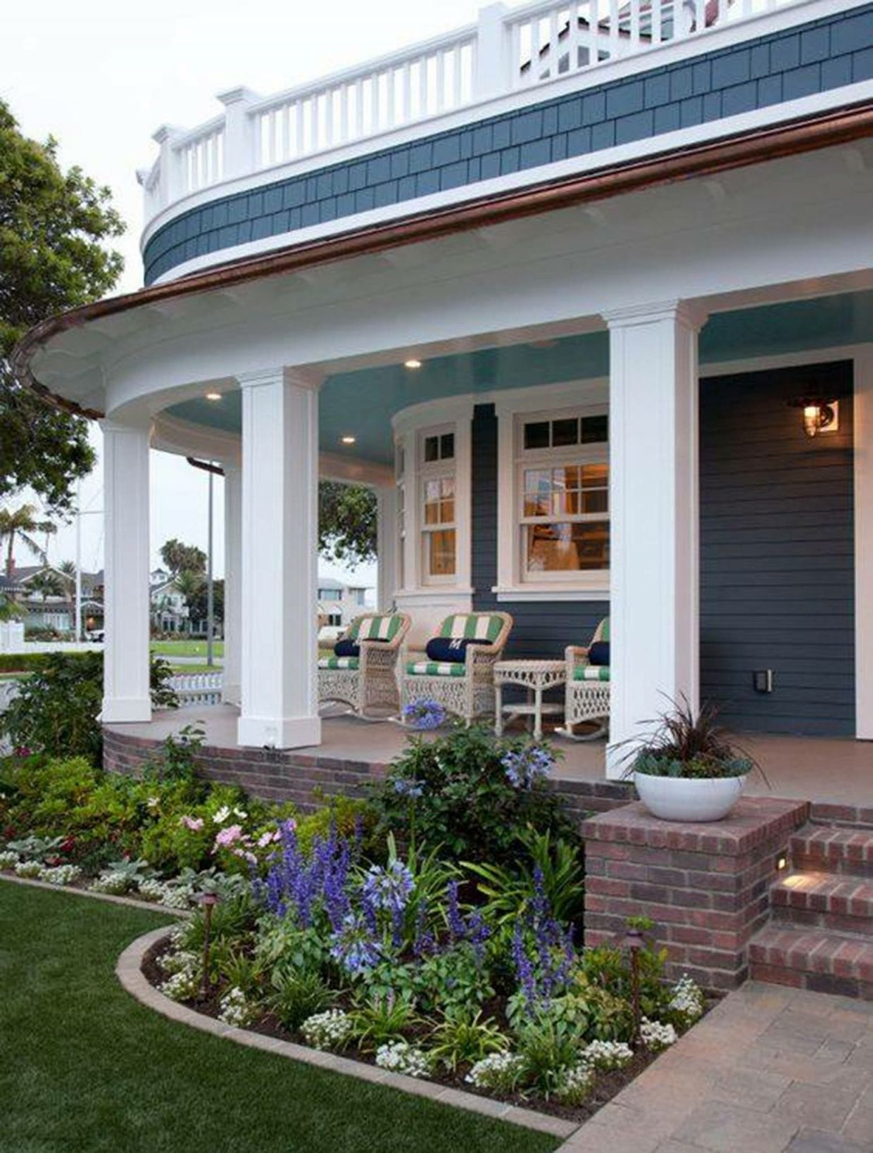 Amazing  landscaping in front of porch